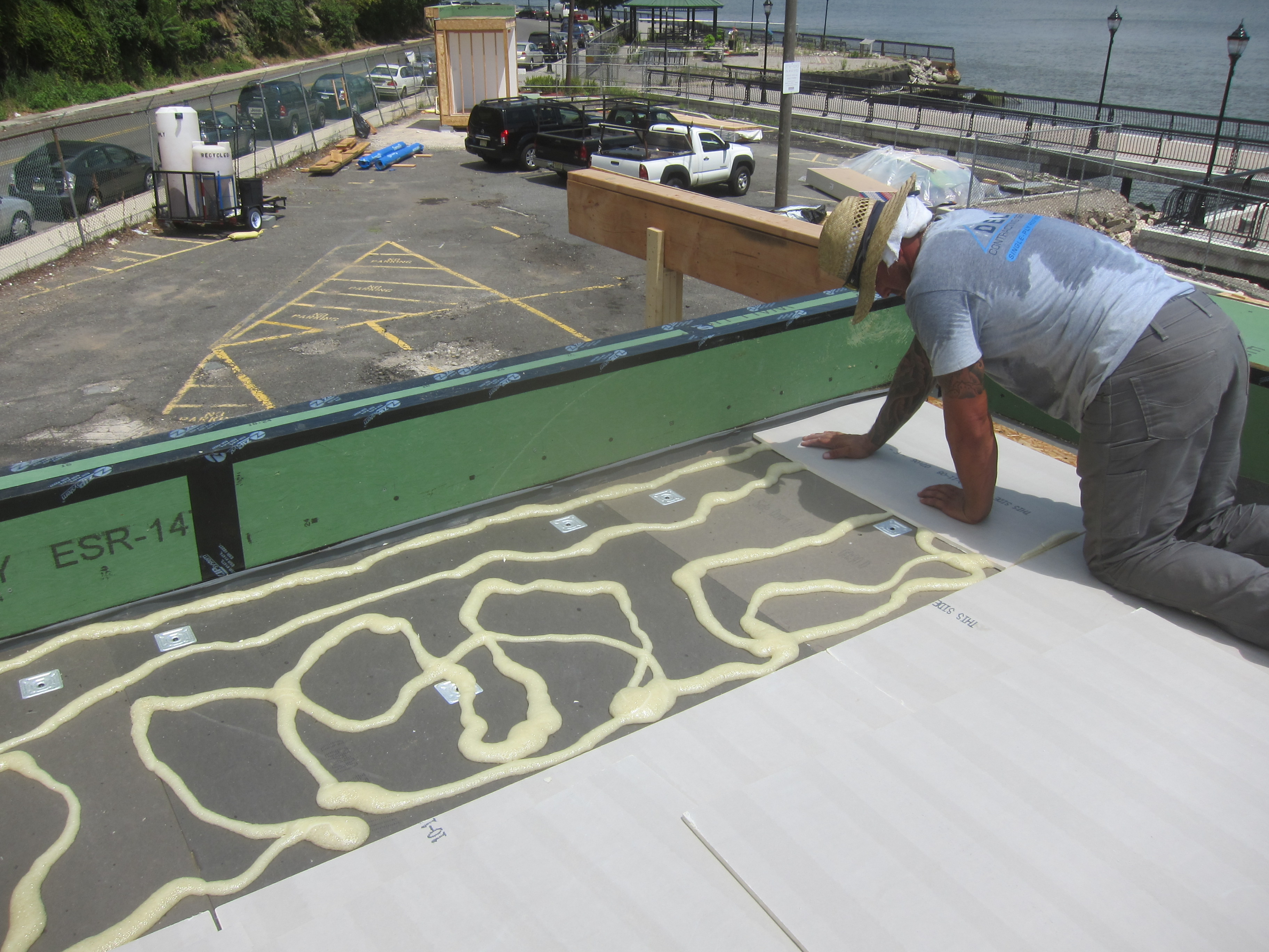 Adhering High Density Polyiso To The Layer Below