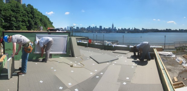 polyiso boards being installed on the roof