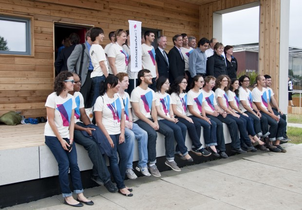 Student team with matching tshirts sits together on the porch of the Empowerhouse.